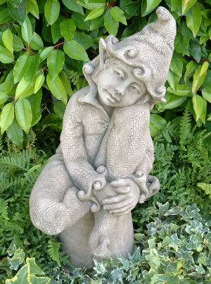 Jenny - a pixie statue with bells on her clothes
