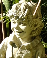 pip laughing fairy stone statue garden ornament-face detail